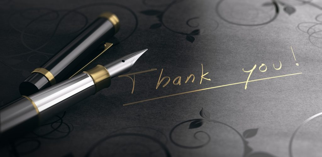 Act Happy Week, Day 3: 3D illustration of a gratitude message over black background. Thank you written in golden letters.